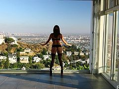 Now that's one hell of a view, and we're not talking about the landscape! Just look at her, what a sexy body she has and that black lingerie makes her even hotter! This cutie can make a man insanely horny after her and this dude is no exception! He approaches her from behind, touches her ass and then she sucks him