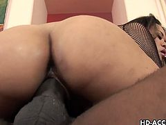 Asian slut with nipple piercing rides a black cock