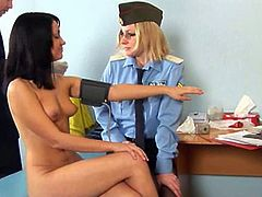 Check out this hot brunette babe getting her tight pussy examined by a horny doctor and a police woman. She is totally naked and they play with her tight holes!
