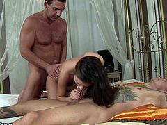 Beautiful brunette Anita Bellini is playing dirty games with two muscular men. She shows her cock-sucking skills to the guys and then enjoys a stunning DP.