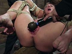 Three hot chicks get tied up and toyed with different dildos in a wooden barn. These chicks also lick each others pussies.