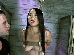 Tied up Asian girl gets her pussy gaped with clothespinned. After that she also gets toyed and fucked in her ass.