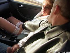 Nasty blonde aunty with filthy mind and insatiable sex hunger gives a head right in the car. Horny man fingers her cunt while she blows him.
