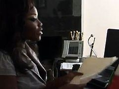 Slutty Black babe blows big black cock passionately. Later on she gets her pussy fucked hard in the office.
