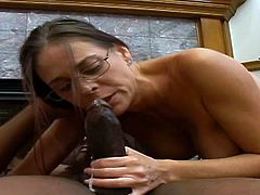 Kinky dark-haired teacher Cheyenne Hunter is gonna prove that she is a good at giving deepthroat blowjobs. She kneels in front of some black stud and drives him mad with her cock-sucking abilities.