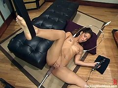 Sexy brunette Isis Love is having some good time in the living room. She caresses herself passionately and then gets her snatch pounded by a fucking machine.