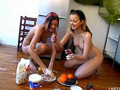 Sexy teens take their clothes off and smear their sexy bodies with different food. Then they lick and fondle each others tits. Later on they also kiss and masturbate.