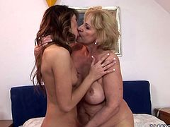Whorish blond grandma takes a shower along with a firm brunette chic. She rubs her shaved cunt before they get out to tongue fuck each other's tasty pussies in steamy sex video by 21 Sextury.
