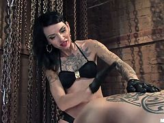 She's sexy and mean, the brunette mistress Simone loves to punish men! This time she has Rico, all tied up on the table and spanks his ass, before fucking it with her strap on dildo. She wants to destroy his self esteem and his ass hole, so let's keep on watching this devilish bitch, and what she will do next!
