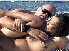 Petite Asian hottie Leilani Li is having fun with some dude on a yacht. She favours the stud with a blowjob and then takes his dick into her hot depths and they fuck in side-by-side position.