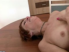 Hot blooded red-haired mature hooks up with a pony looking young fucker. She rides him reverse before giving his anus riming as he bends over a table in insane sex video by 21 Sextury.