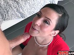 Colombian milf Ariella Ferrera is Michael Vegas's girlfriend's step mom and she has heard from her daughter that he has a very big cock. His girlfriend and the sexy milf jack him off then suck his cock in the kitchen.