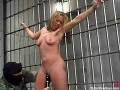 Sexy blonde girl gets undressed and tied up Sgt. Major. After that she gets toyed with a vibrator and humiliated in filled aquarium.