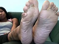 Tattooed ebony with nice feet