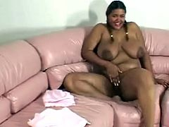 Busty ebony slut with big nipples and pigtails showing off her pussy by masturbating for the camera and fingering it really good.