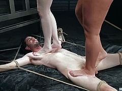 Claire Adams and Fiona Cheeks tie up and gag a guy. Then they step on him and toy his ass with a strap-on. Later on they also ride his dick like wild animals.