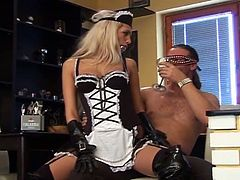 This hot blonde is wearing a maid uniform with high latex boots and she has a gag in her mouth. This guy fucks her fanny and he cums on her boots. She licks that cum.