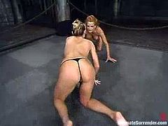 Janay and Shannon Kelly are having a tussle on tatami. The blondes struggle with each other furiously and then play some dirty games with a strapon.
