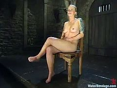 This divine blond angel Angelene Black is going through some very unpleasant feelings, being immersed upside down and then tortured, being tied up on the yoke bar.