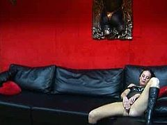 Horn made brunette slut in seducing black lingerie and high heels sits on the couch tickling her soaking twat with fingers before a kinky dude approaches her to receive professional blowjob.