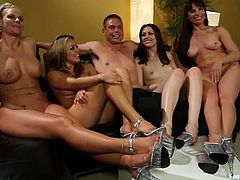 Stunning babes lick their feet and give hot footjob to some dude. Later on they toy and feet finger each others wet pussies.