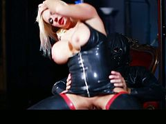 Seductive blonde MILF is looking hell seductive wearing rubber corset and stockings. She bounces on a hard stick actively. Then she is nailed bad from behind. Hot and sexy woman is screwed bad in hot XXX porn clip.