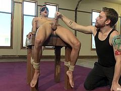 Johnny Torque gets tied up and blindfolded by two other men. Then these guys suck Johnny's dick and gives him a handjob. Then they also lick his ass.