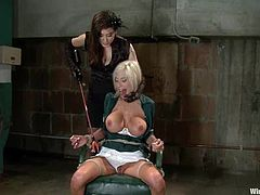 This gorgeous and smoking hot blond siren gets naked for Isis Love and Princess Donna Dolore. They tie her up and starts playing with her wet pussy in bondage!
