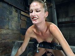 Brunette girl lies on the floor being tied up. Then her master fixes claws to nipples and toys the pussy.