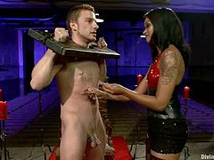 Sebastian Keys is getting naughty with beautiful ebony chick Skin Diamond. Skin attaches clothes pegs to Sebastian's body and then rubs her pussy against the dude's schlong.