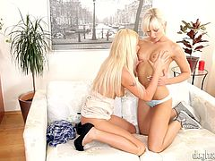 These two sexy blonde girls kiss each other and lick each other's boobs. Watch they make out with each other. One pulls the other's panties aside and rubs her sexy, moist pussy. When her hands slides down into her lover panties, she gets wet, too.