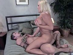 Chubby blonde milf Alexis Golden is having BDSM fun with Danny Wylde in a bedroom. She binds the stud and makes him eat her cunt and then destroys his butt with a strapon.