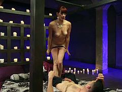 Maitresse Madeline is having fun with some guy in the bedroom. The dude licks and sucks Maitresse's toes and then pleases the hussy with cunnilingus and enjoys a hot footjob.