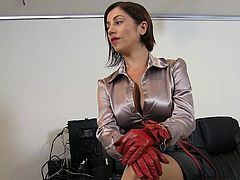 Ella Kross is wearing leather gloves and spanking a guy