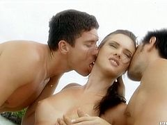 A yacht is the setting where Jennifer Dark is enjoying an MMF threesome outdoors where she enjoys the sea and the double penetration.
