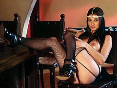Adorable Erika Knight in black lingerie and high heels makes hot solo show. She shows her hot tits and drinks some wine.