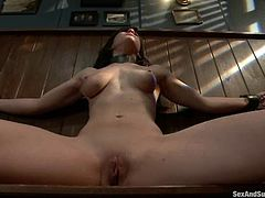 Stunning brown-haired girl poses naked and shows a dildo in her ass. After that she gets tied up with straps and fucked hard in her ass.