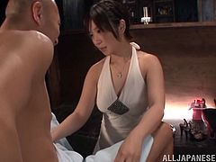 Beautiful japanese girlfriend with dress on and cute face gives blowjob to bald asian dude with small cock. She gets his cum out of his cock.