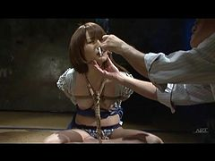 Cigarettes up the nose of bound Japanese girl