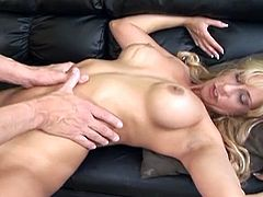 This blonde milf has a fit body and big jugs. She deepthroats this guy's cock before he shoves it in her bald pussy and pushes it in quite rough. She swallows his jizz.