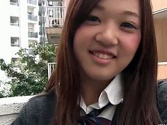 This seemingly shy Japanese schoolgirl tries a vibrator. She puts it inside her pussy and then she puts her panties back on. She walks around with it in the street.
