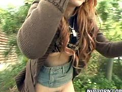 Nasty Asian ginger haired slut is proud to expose her hairy pussy and her sweet ass outdoors. One guy plays with her soft perky tits and stretches her dark asshole with his fingers.