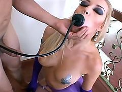 Anal play in purple fishnets and gloves