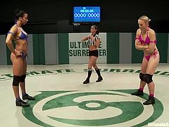 Dylan Ryan and Sophia Fiore wrestle in a ring. The brunette girl holds a victory, so the blonde sucks a strap-on and then gets toyed.