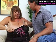 Handsome guy picks up fat slut at the parking lot. He finds out that she doesn't mind making porn video. So he takes her to the studio where he tit fucks her hard.