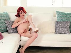 Gorgeous Elle Alexandra takes her lingerie off and lies down on a sofa. She shows her nice tits and pink pussy.