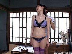 Horny Japanese MILF with juicy tits poses for the camera. Then she gives a blowjob to a guy in POV video.