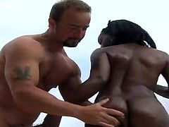 White dude is dominating over this smoking hot ebony babe! She closes her eyes, sucking that dick and keeps them closed, when he penetrates her!