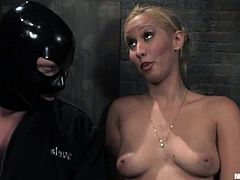 J Seven wearing a mask is having fun with Isis Love in a basement. He lets the mistress tie him up and torture him and then Isis fucks J's ass with a strapon.