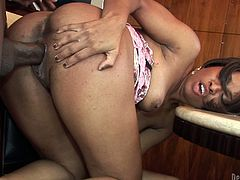 Luscious ebony hooker has got curvy tempting body. Thirsty black stud eats her tasty wet pussy that is gushing juices. Then he bends her over the dining table banging hard from behind.